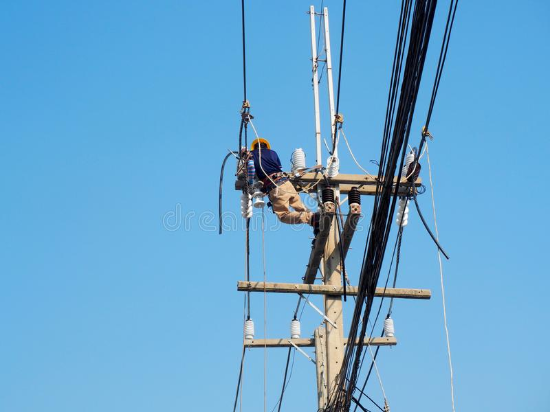 electrician man working at height and dangerous stock photography