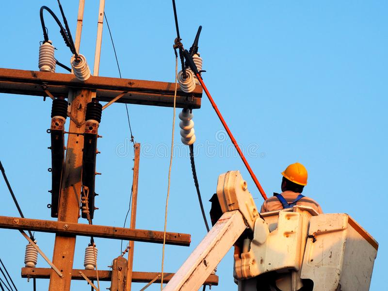 electrician man working at height and dangerous royalty free stock image