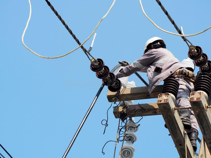 electrician man working at height and dangerous stock image