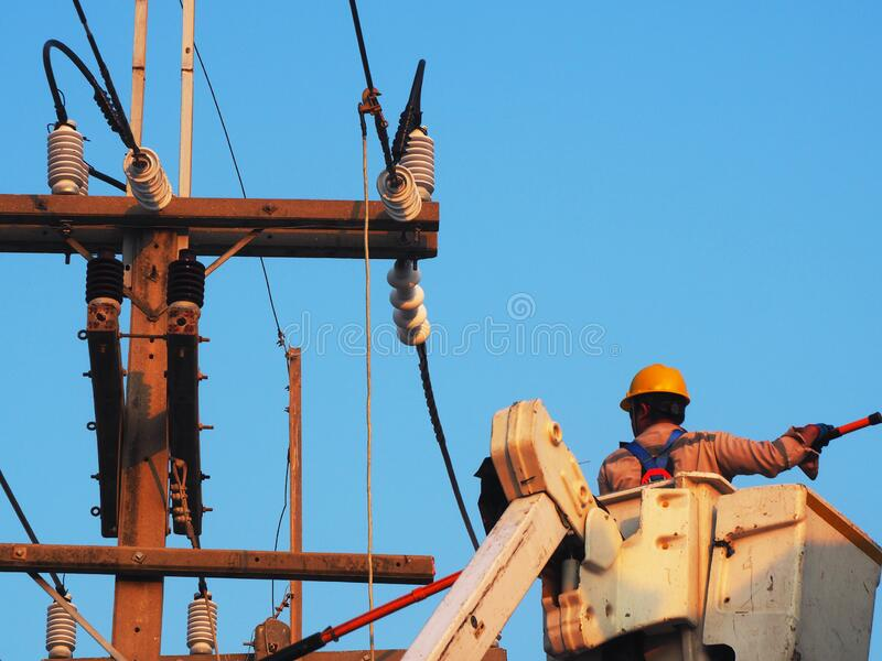 electrician man working at height and dangerous stock photos