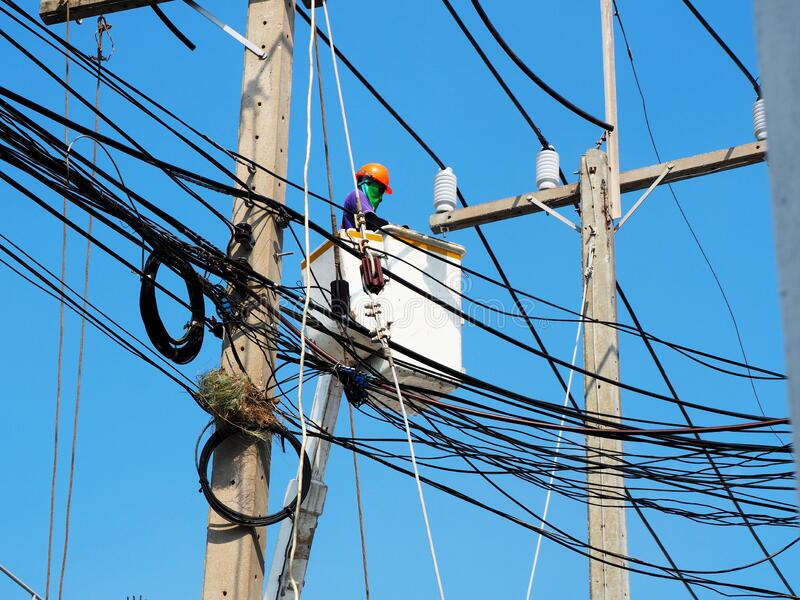 electrician man working at height and dangerous royalty free stock images