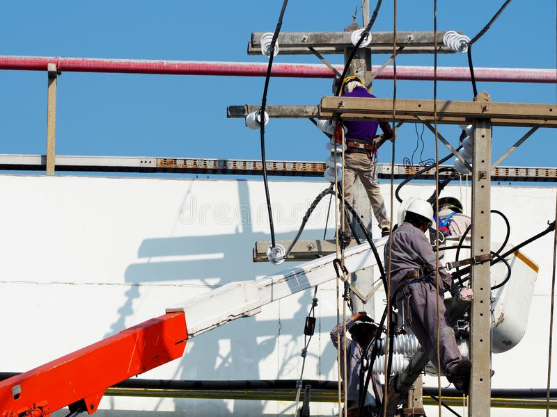 Electrician man working at height and dangerous stock photo