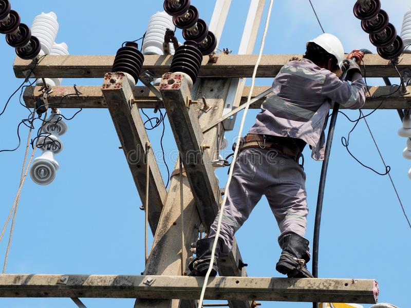 electrician man working at height and dangerous royalty free stock photography