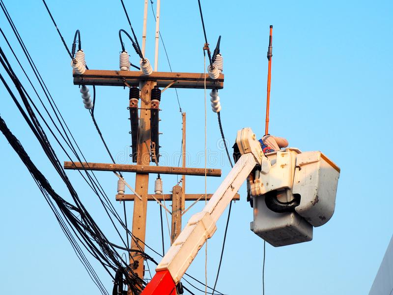 electrician man working at height and dangerous royalty free stock photos