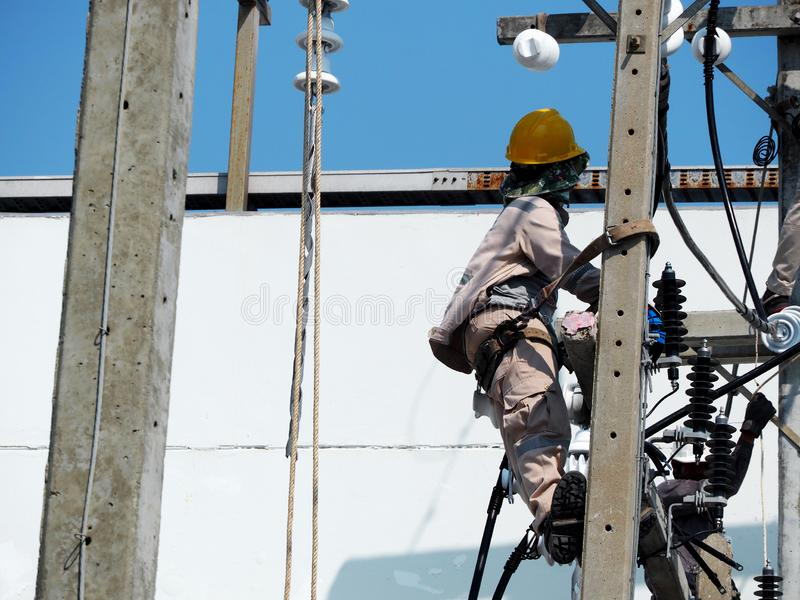 electrician man working at height and dangerous stock images