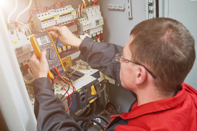 Electrician measurements with multimeter tester stock photos