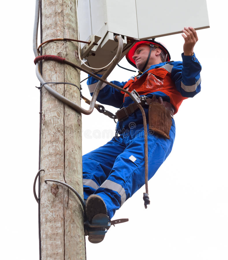 Electrician opened the control panel on the pole reclosers stock image