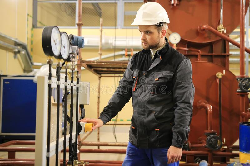 Electrician operator inspect and checking heating ventilated and air conditioning equipment. HVAC engineer checking manometer royalty free stock photo