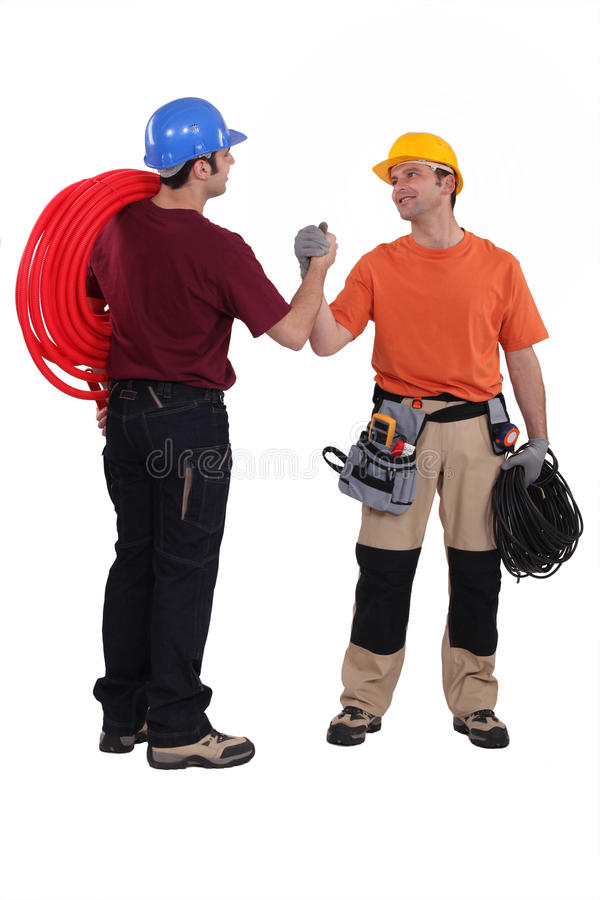 Electrician and plumber royalty free stock images