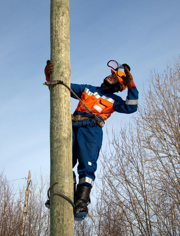 Download Electrician on a pole stock image. Image of climb, overalls - 19021827