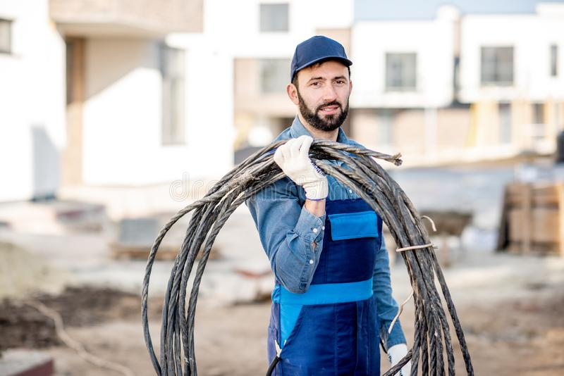 Electrician portrait with power cable royalty free stock photography