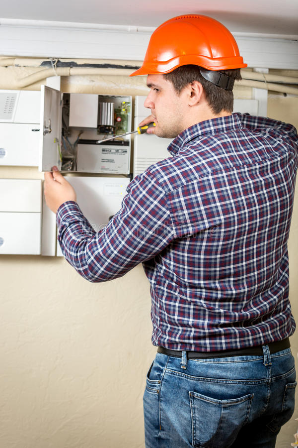 Electrician repairing electrical board at home royalty free stock photo