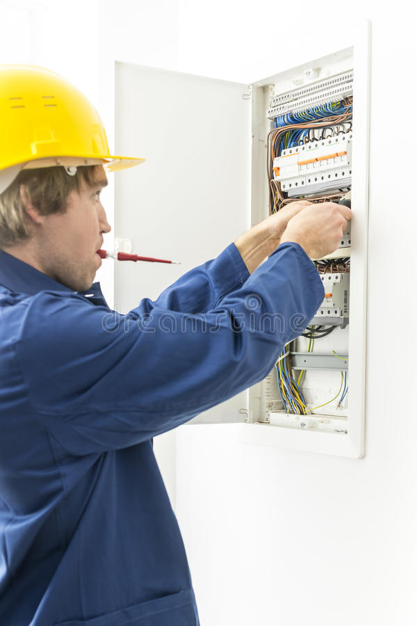Electrician repairing fuses stock images