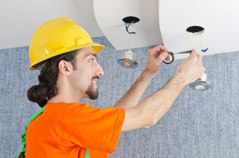 Electrician repairman working stock images
