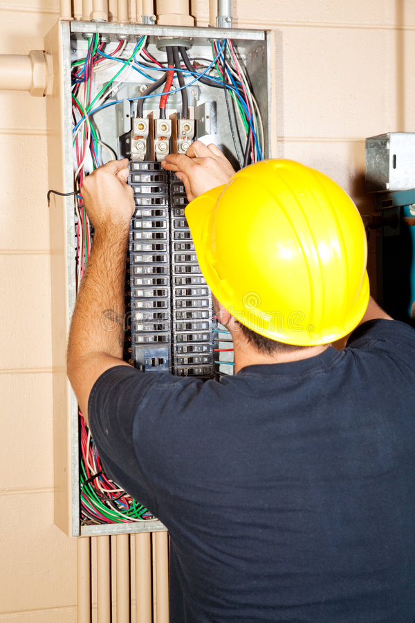 Electrician Replaces Breaker royalty free stock images