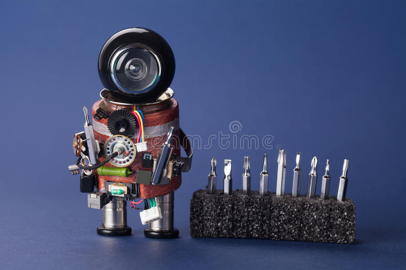 Electrician robot with screwdriver set. Fun service character, black helmet head and handyman instrument. Macro view royalty free stock image