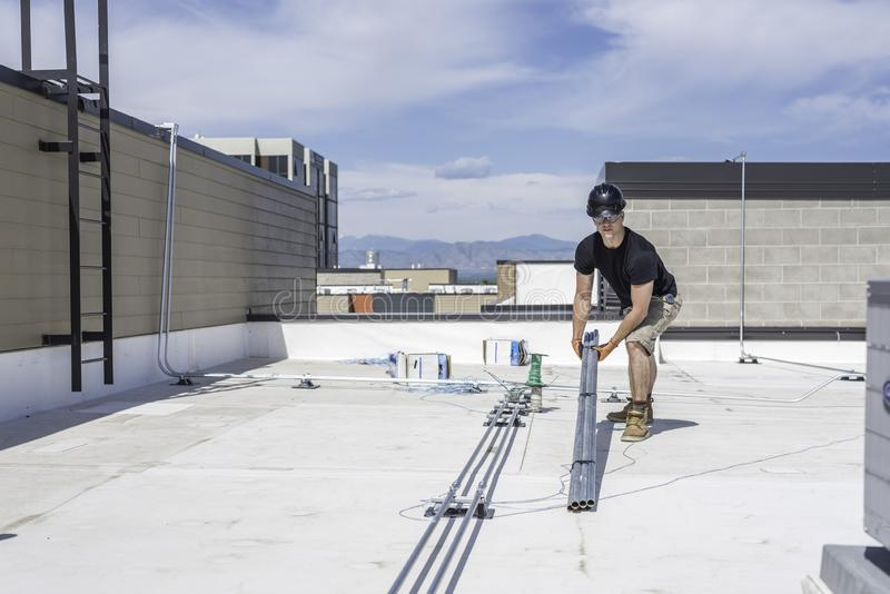 Electrician on Roof stock image