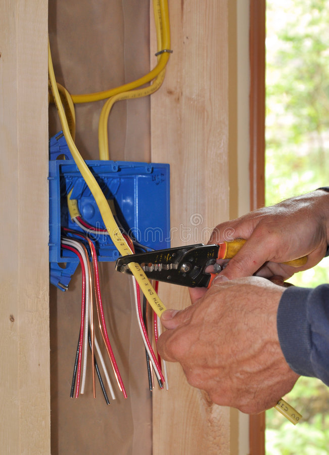 Free Electrician S Hand Stripping Wire Stock Image - 9315351