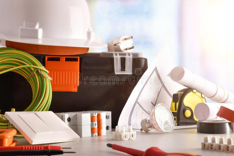 Electrician`s office desk with electrical equipment window background front view royalty free stock images
