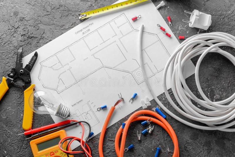 Electrician\'s supplies with house plan on grey background royalty free stock photos