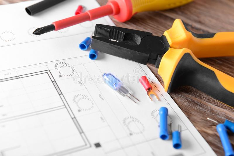 Electrician's supplies with house plan on table stock image