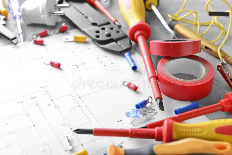 Electrician's supplies and house plan on table royalty free stock photos