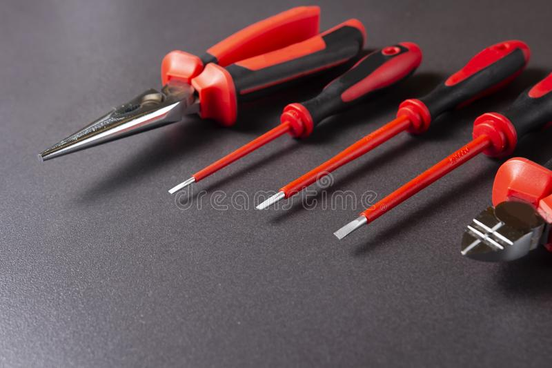 Electrician`s tools screwdrivers, nippers, pliers. Electro-insulated tool for working with electricity up to 1000 volts. royalty free stock images