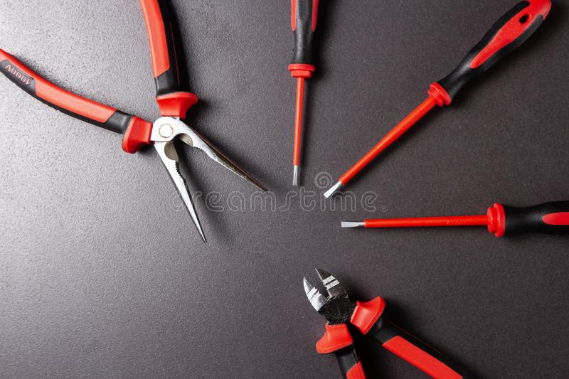 Electrician`s tools screwdrivers, nippers, pliers. Electro-insulated tool for working with electricity up to 1000 volts. stock photos