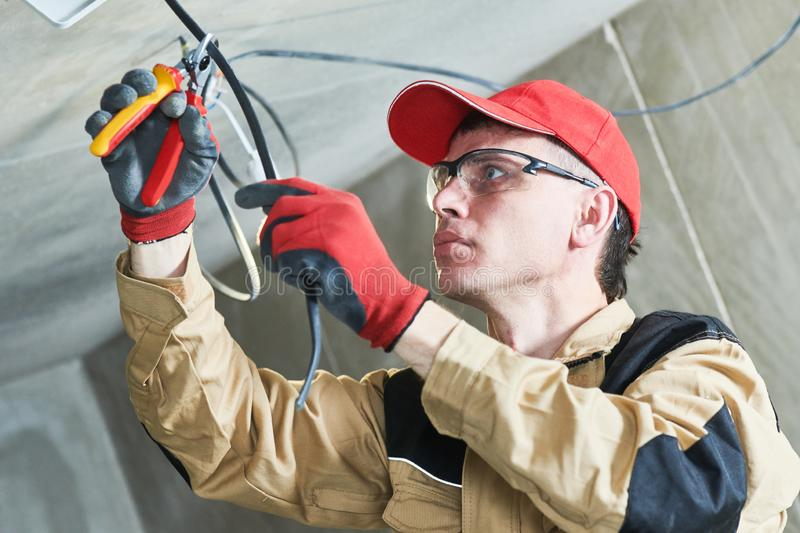 Electrician service. Installer works with cable royalty free stock photos
