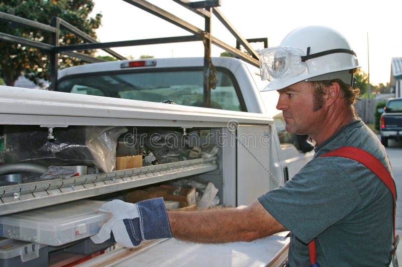 Electrician with Service Truck 1 royalty free stock image