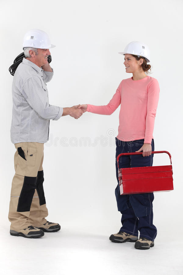 Electrician shaking hands w stock photos