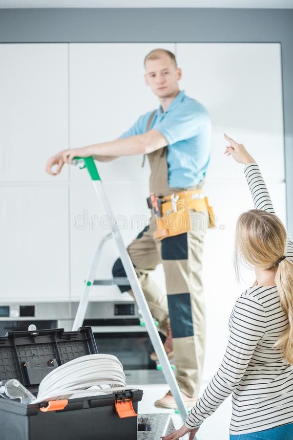 Electrician standing on ladder royalty free stock image