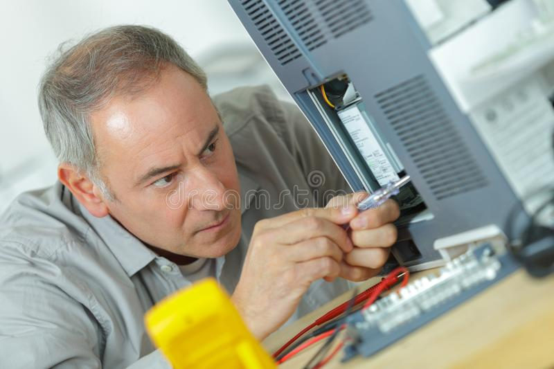 Electrician stripping end wire royalty free stock photography
