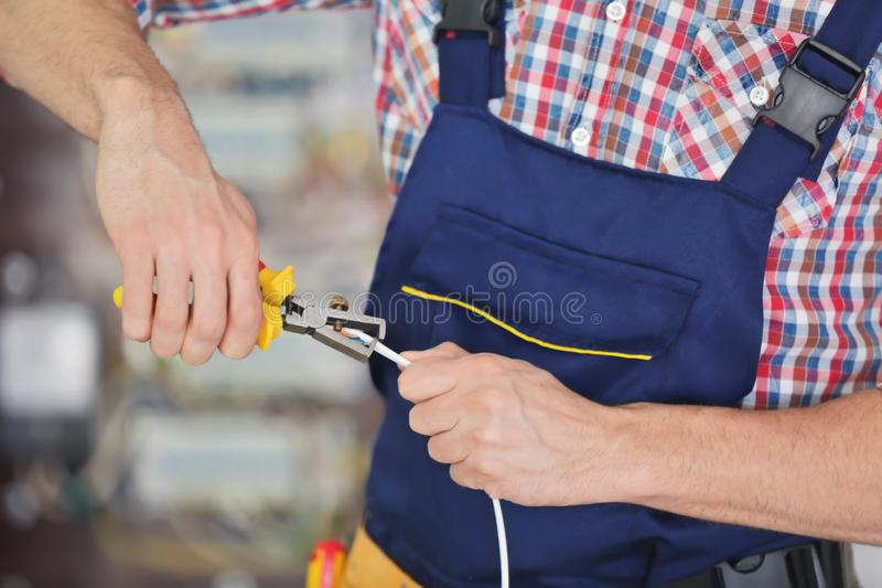 Electrician stripping end of wire royalty free stock photography