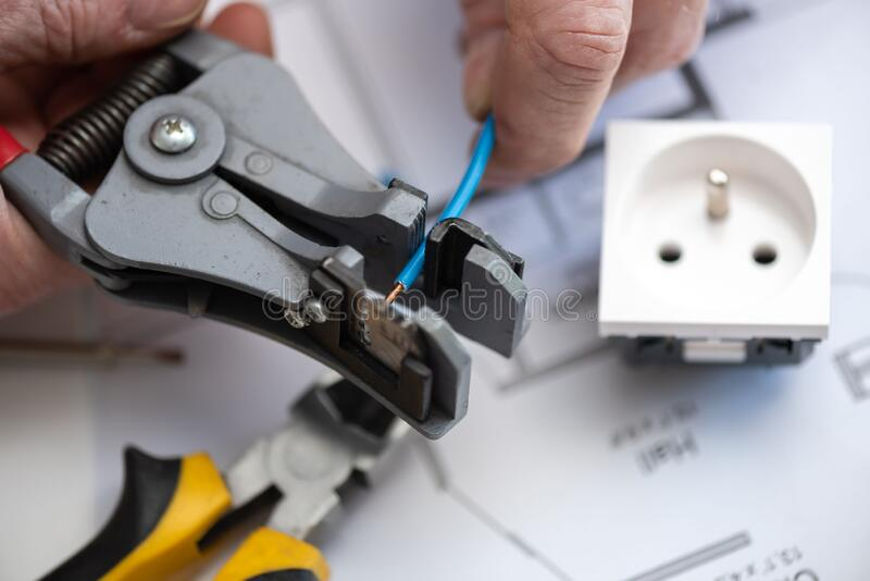 Electrician stripping a wire royalty free stock photos