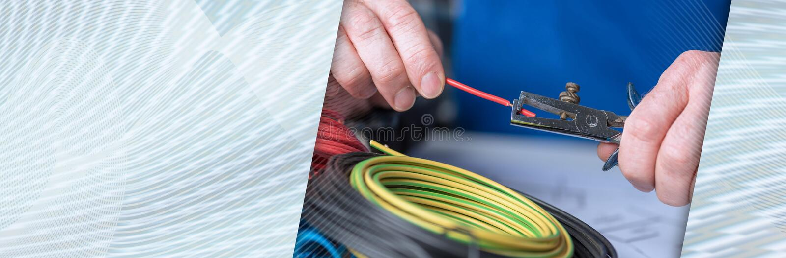 Electrician stripping a wire. panoramic banner stock photography