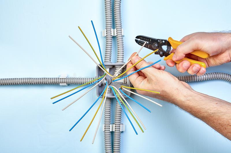 Electrician strips wire use wire stripper royalty free stock photos