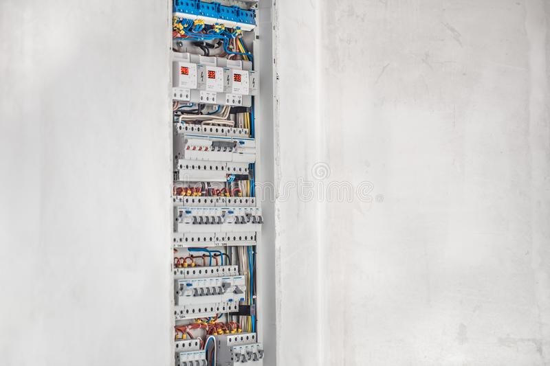 Electrician, switchboard with fuses. Connection and installation in the electrical panel with modern equipment stock photo