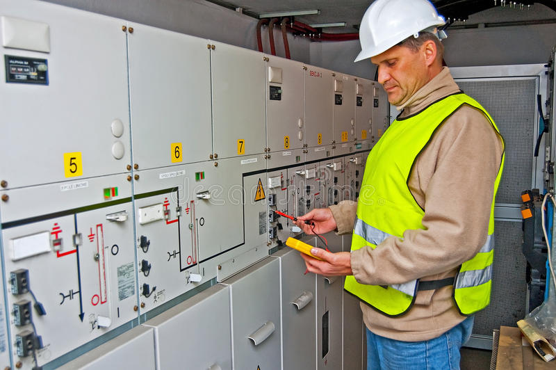 Electrician in switching power royalty free stock image