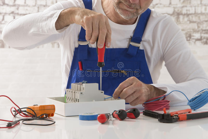 Electrician. Technician, engineer working on power box royalty free stock photography