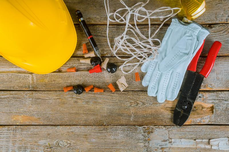 Electrician technician at work prepares the tools and cables used in electrical installation and yellow helmet stock photos