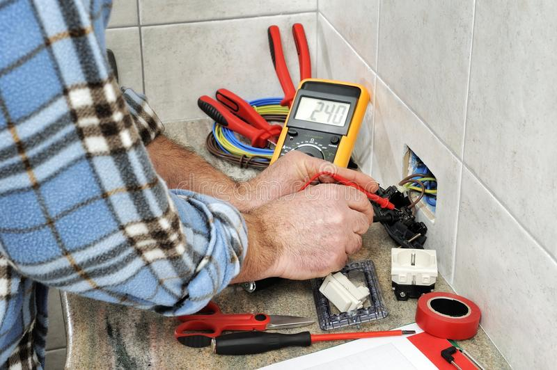 Electrician technician at work on a residential electric system. stock photo