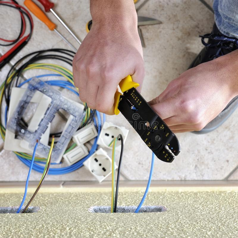 Electrician technician at work on a residential electric system stock photo