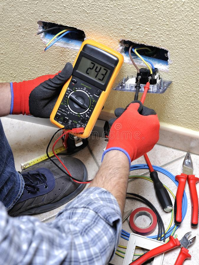 Download Electrician Technician At Work With Safety Equipment On A Residential Electrical System Stock Photo