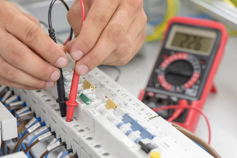 Electrician Testing an Electric Smart Panel royalty free stock photo