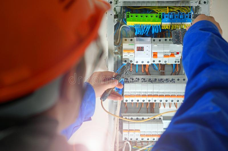 Electrician testing the electrical shield. stock image