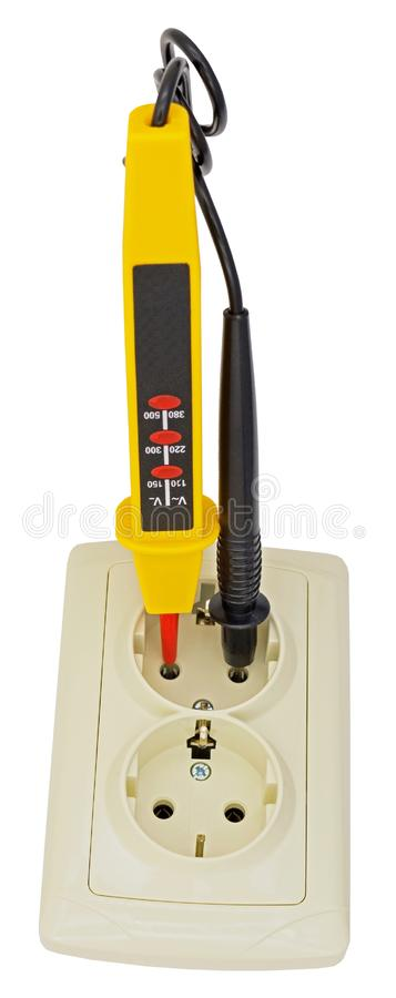 Electrician testing for electricity with a voltage tester. Electrician testing for electricity in Electric extension with a voltage tester or phase indicator stock photo