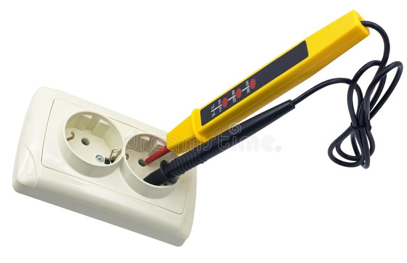 Electrician testing for electricity with a voltage tester. Electrician testing for electricity in Electric extension with a voltage tester or phase indicator stock image