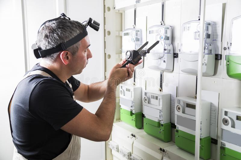 Electrician testing equipment in fuse switch box close up stock image