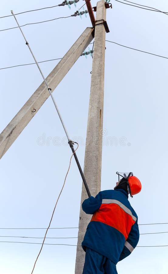 Electrician to install a protective ground connection to the pow stock images